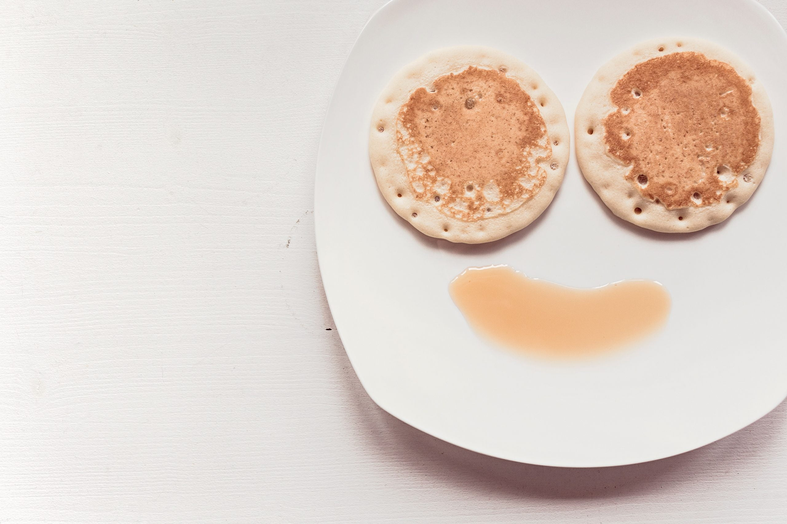 Pancake and syrup showing a smiley face representing unique promotional event